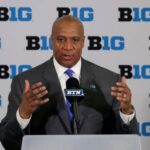 Big Ten commissioner Kevin Warren standing at lecturn