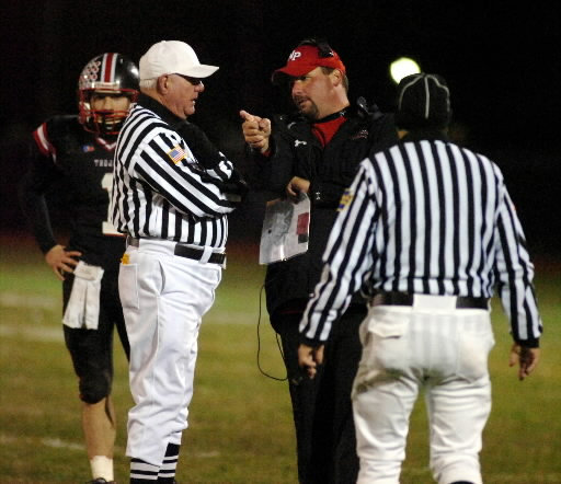 Football coach arguing with officials.