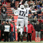 Two Penn State players celebrate an interception