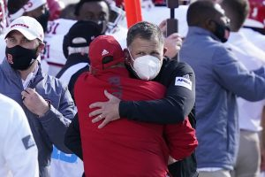 Greg Schiano hugging an assistant